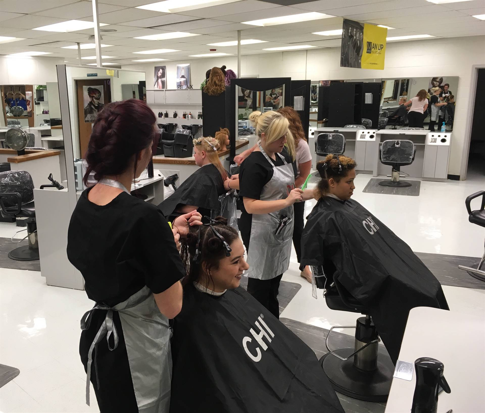 photo of students cutting hair