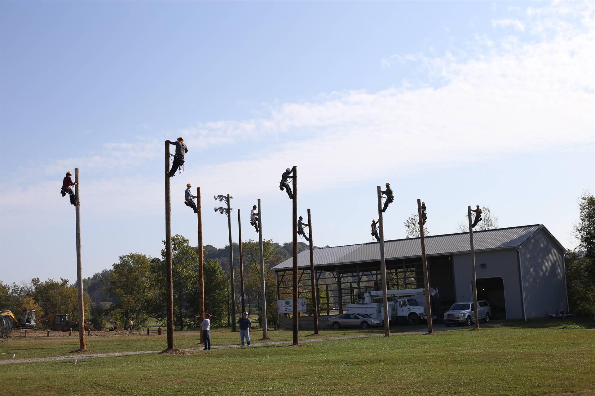 students on poles